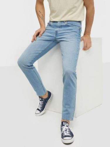 Levis 512 Slim Taper Manilla Bean Ad Jeans Indigo