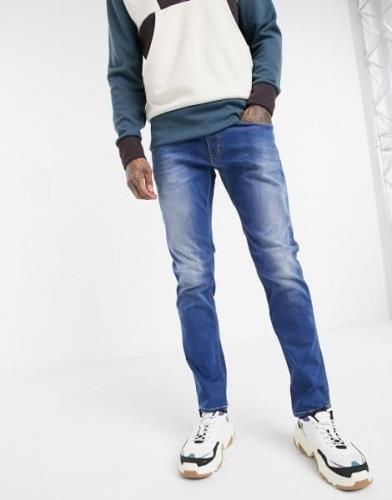 Replay Anbass slim fit power stretch jeans in mid wash-Blue